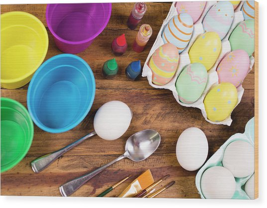 Easter Eggs Being Decorated On Wooden Wood Print by Fstop123