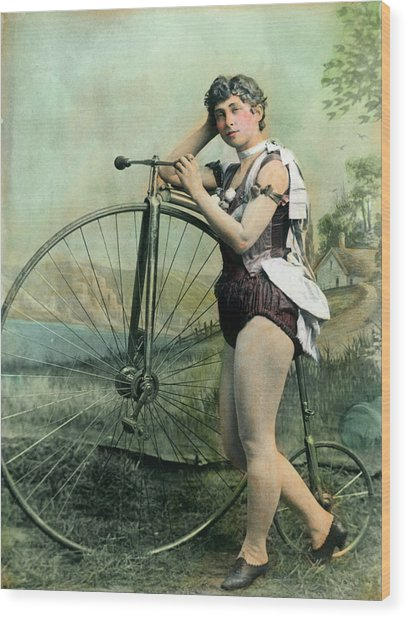 Female Circus Performer With Bicycle Wood Print by Bettmann