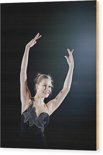 Female Figure Skater Posing With Arms Wood Print by Thomas Barwick