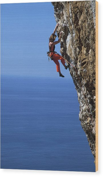 Female Free Climber Scaling Rock Face Wood Print