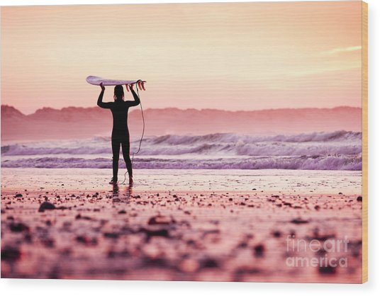 Female Surfer On The Beach At The Sunset Wood Print