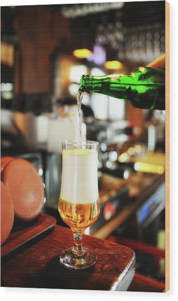 Filling A Beer Glass On The Bar Counter Wood Print