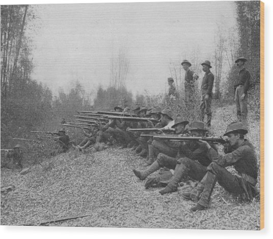Firing On Insurgents Wood Print by Hulton Archive