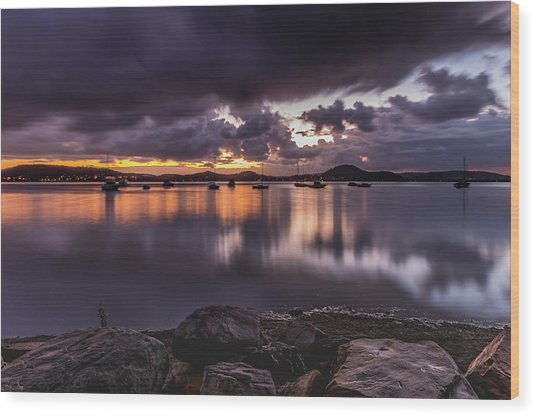 First Light With Heavy Rain Clouds On The Bay Wood Print