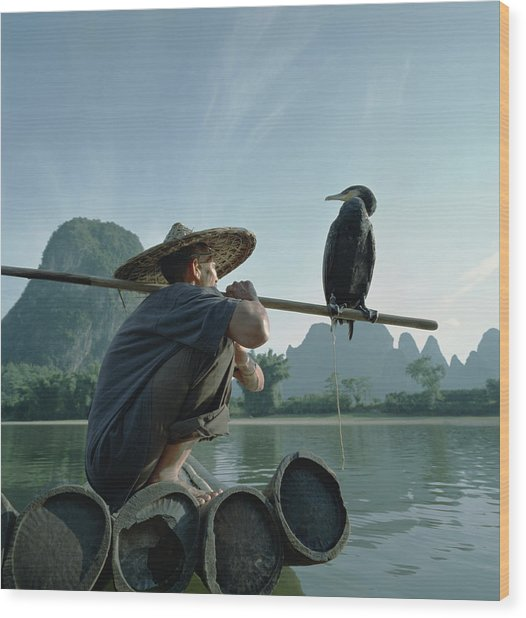 Fisherman Sitting On Bamboo Raft With Wood Print