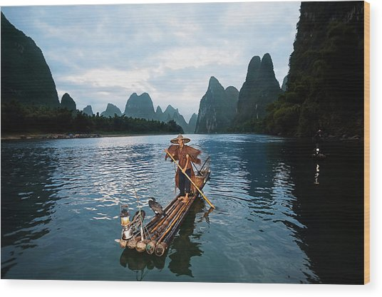 Fisherman Standing On A Wooden Raft In Wood Print