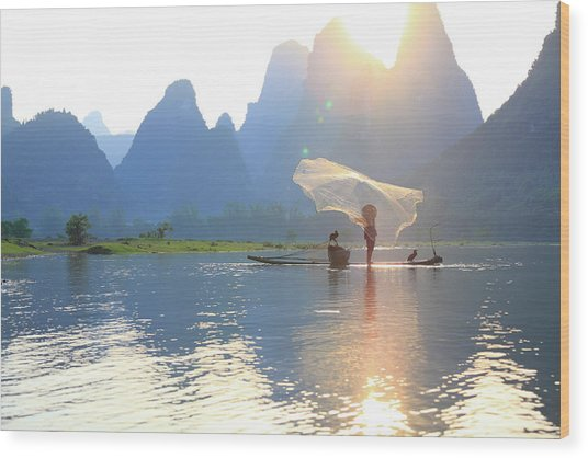 Fishing On The Li River Wood Print by Bihaibo