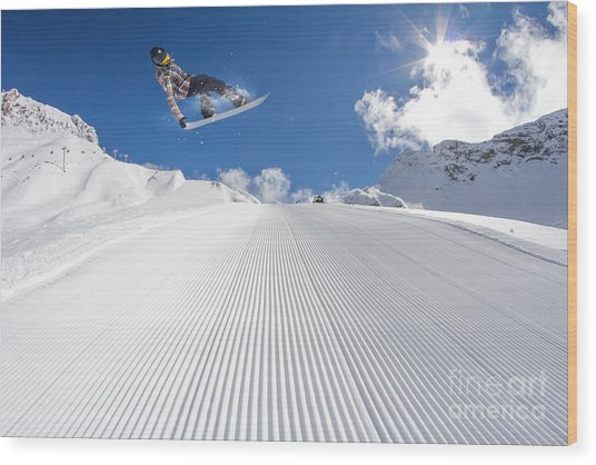 Flying Snowboarder On Mountains Wood Print