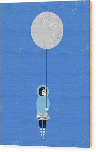 Girl Holding Full Moon Balloon Wood Print