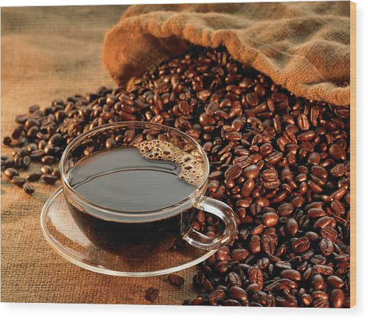Glass Coffee Cup With Beans On Warm Wood Print