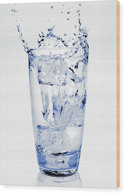 Glass Of Water Splashing Around Wood Print by Maria Toutoudaki