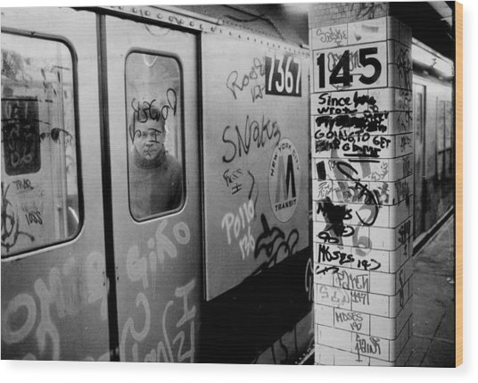 Graffiti Covers Platform And Subway At Wood Print by New York Daily News Archive