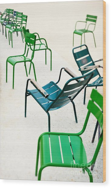Green Metallic Chairs In The City Park Wood Print