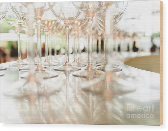 Group Of Empty Transparent Glasses Ready For A Party In A Bar. Wood Print