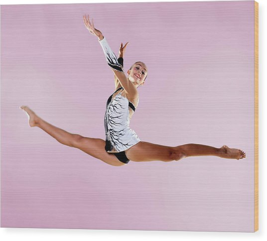Gymnast, Split, Mid Air, Black And Wood Print by Emma Innocenti
