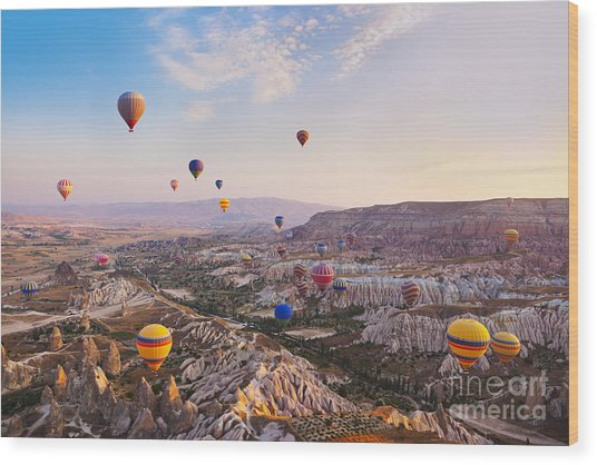 Hot Air Balloon Flying Over Rock Wood Print