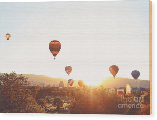 Hot Air Balloons In The Sky During Wood Print by Annette Shaff
