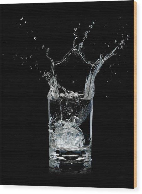 Ice Splashing Into Water Glass Wood Print by Chris Stein