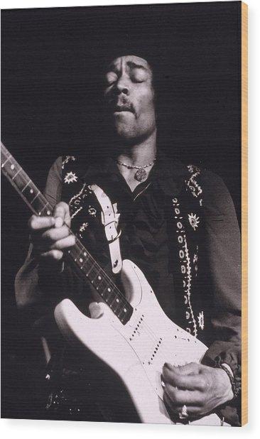 Jimi Hendrix Performs Wood Print by Hulton Archive