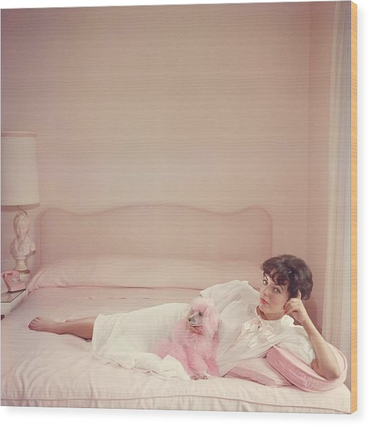 Joan Collins Relaxes Wood Print by Slim Aarons