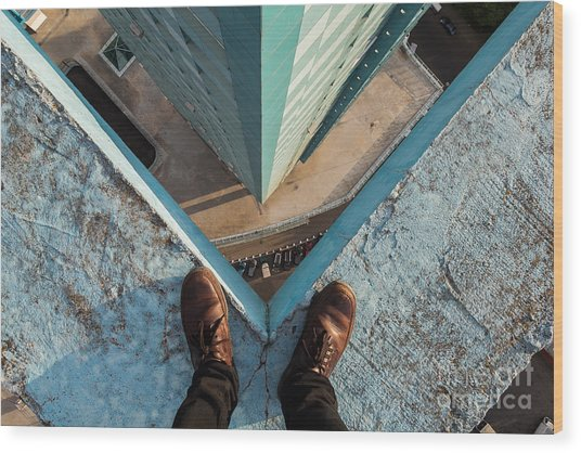 Legs Of A Man Standing On The Edge Wood Print