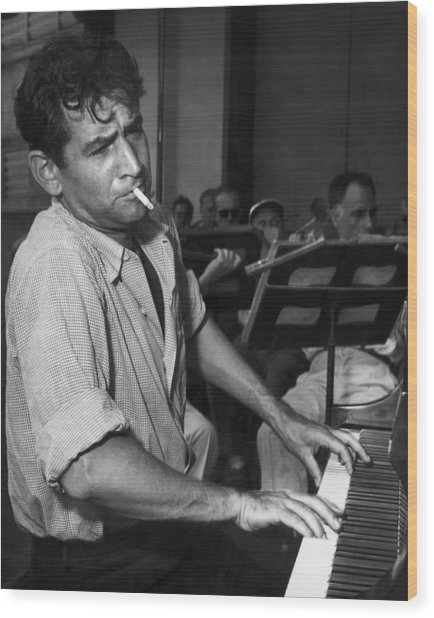 Leonard Bernstein Smoking At Piano Wood Print by Bettmann