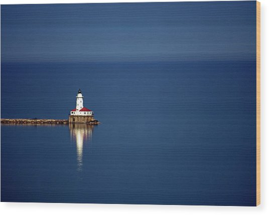 Lighthouse On A Lake Wood Print by By Ken Ilio