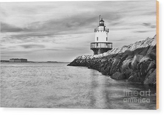 Lighthouse On Top Of A Rocky Island In Wood Print