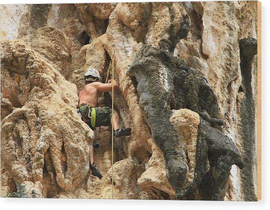 Man Climbing Rock Wood Print