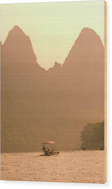 Man In Bomboo Raft On Li River At Sunset Wood Print