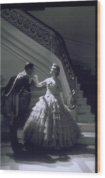 Man Kisses Hand Of Woman In Ball Gown Wood Print by Archive Holdings Inc.