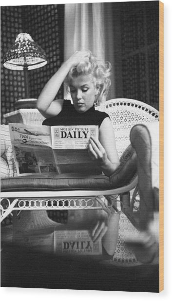 Marilyn Relaxes In A Hotel Room Wood Print by Michael Ochs Archives
