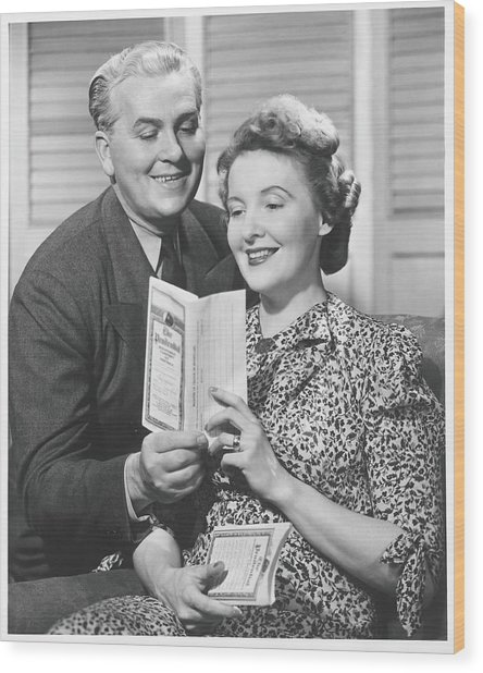 Mature Couple Looking At Brochure, B&w Wood Print by George Marks
