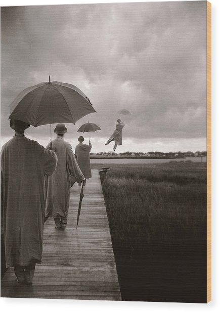 Men With Umbrellas Flying  Into Sky Wood Print by Bryce Lankard
