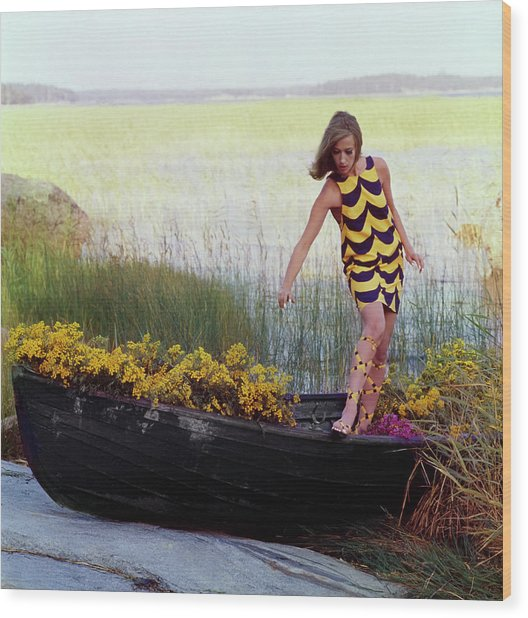 Model In Rowboat Filled With Yellow Flowers Wood Print by Gordon Parks