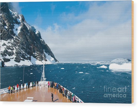 Mountains And Cruise Ship In Antarctica Wood Print
