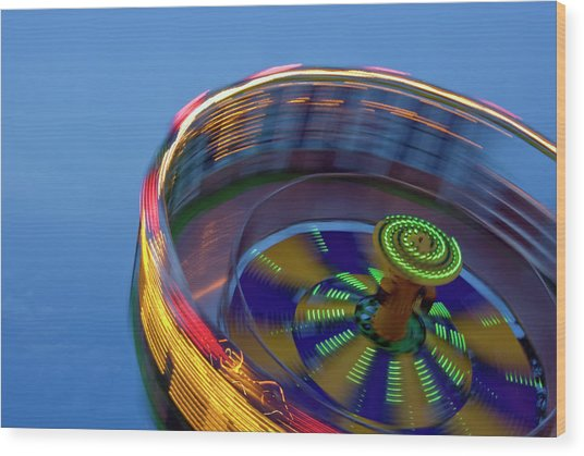 Multicolored Spinning Carnival Ride Wood Print by By Ken Ilio