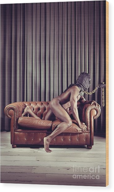 Naked Man With Mask On A Sofa Wood Print