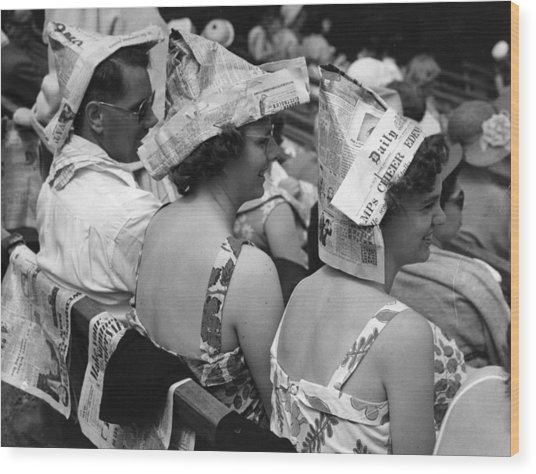 Newspaper Hats Wood Print by Fox Photos