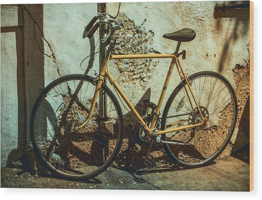 Old Bike Against And Old Wall Wood Print