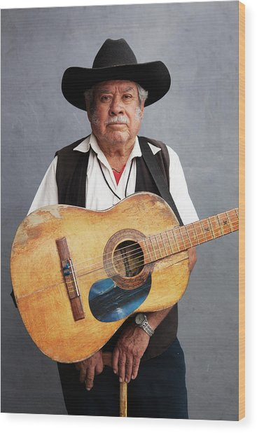 Old Man With His Hat, His Guitar And Wood Print