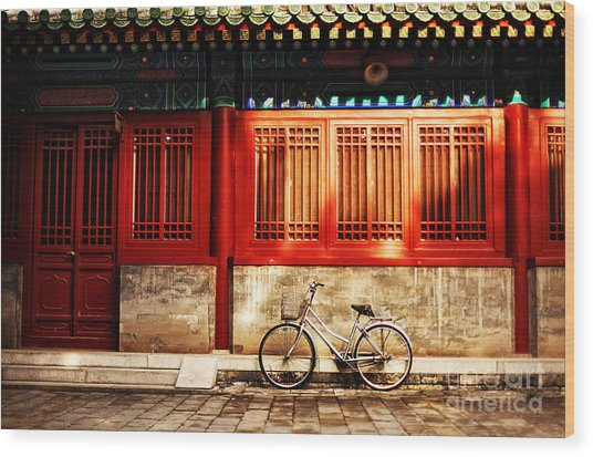 One Bicycle In Front Of Oriental Red Wood Print