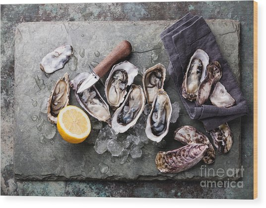 Oysters On Stone Plate With Ice And Wood Print