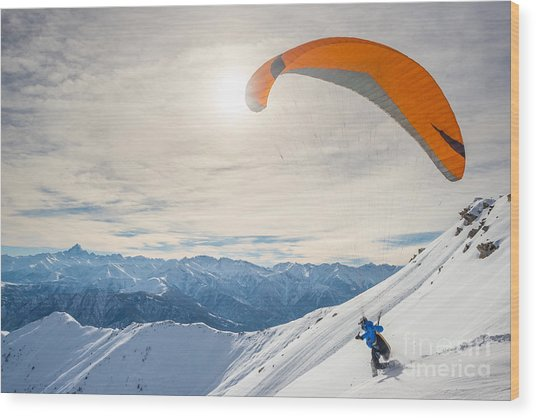 Paraglider Running On Snowy Slope For Wood Print