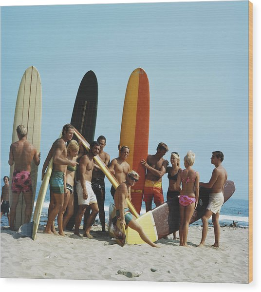 People On Beach With Surf Board Wood Print