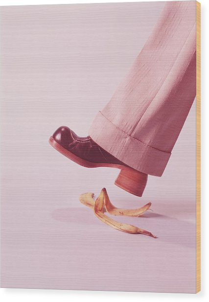 Person About To Step On Banana Skin Wood Print by H. Armstrong Roberts