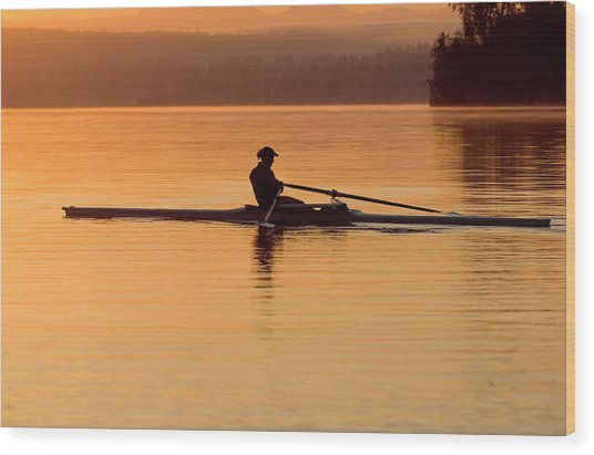Person Rowing Sculling Boat On River Wood Print by Pete Saloutos
