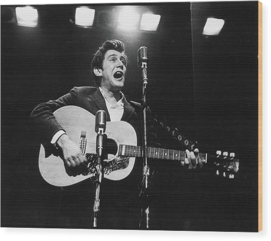 Phil Ochs Performs On Stage Wood Print by Fred W. McDarrah