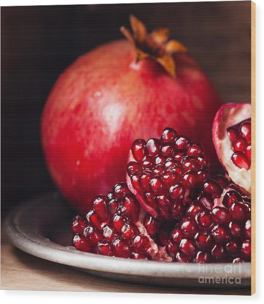 Pieces And Seeds Of Ripe Pomegranate Wood Print