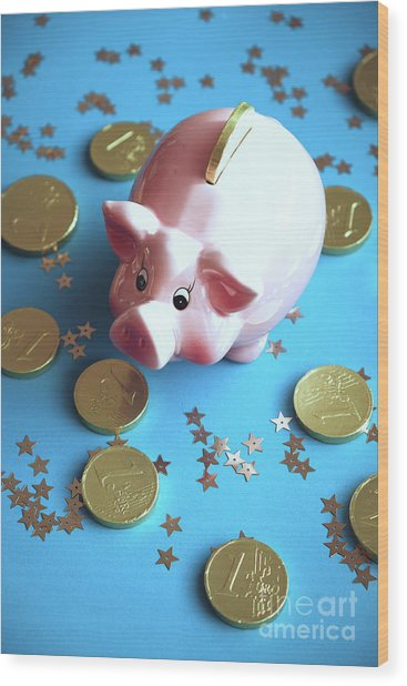 Piggy Bank On The Background With The  Chocoladen Coins Wood Print